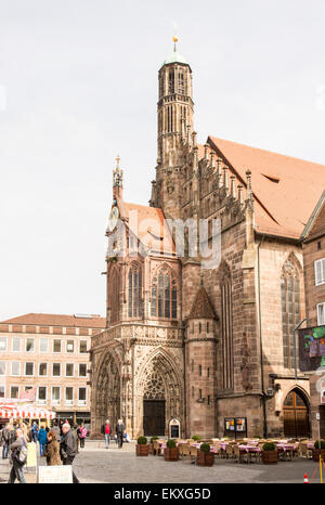 NUERNBERG, GERMANY - APRIL 9: Tourist at the Frauenkirche in Nuernberg, Germany on April 9, 2015. The church is - Stock Photo