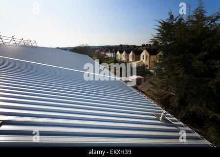 Standing seam roofing with fall arrest blocks and safety wire - Stock Photo