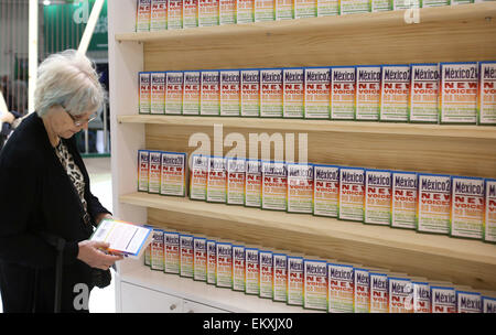 London,  UK. 14th Apr, 2015. A reader looks at a book at the London Book Fair in Olympia, London, Britain on April - Stock Photo