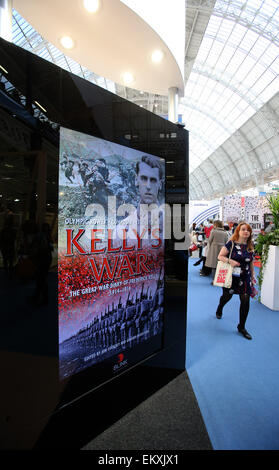 London,  UK. 14th Apr, 2015. A visitor passes by an exhibition booth at the London Book Fair in Olympia, London, - Stock Photo