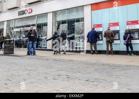 HSBC bank - York main branch in the city centre with people using cashpoints ATMs a cashpoint ATM. - Stock Photo