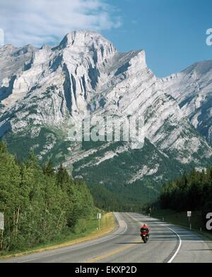 Motorcycling In The Mountains; Kananaskis, Alberta, Canada - Stock Photo