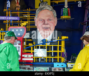 Two men examine the Amend-O-Matic StampMobile, a sculpture-machine designed as a protest against Citizens United - Stock Photo