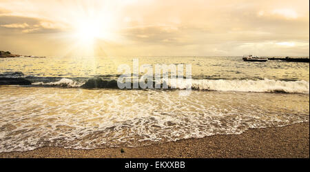 Beautiful evening sun and clouds over the sea - Stock Photo