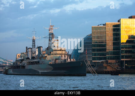 HMS Belfast museum ship Royal Navy light cruiser, moored in London on the River Thames and operated by Imperial - Stock Photo