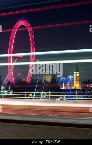 Traffic light trails on Waterloo Bridge with London Eye and Big Ben in the background , London, UK - Stock Photo