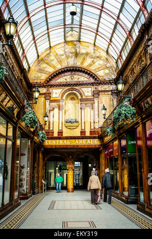 Shoppers walk through the historic Central Arcade established in 1906 in Newcastle Upon Tyne, UK. - Stock Photo