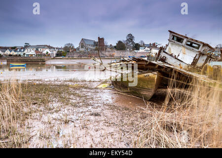 Old boats at low tide on the River Exe at Topsham, Devon, England, United Kingdom, Europe. - Stock Photo
