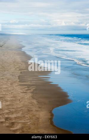 Sandy beach along the Pacific coast; Oregon, United States of America - Stock Photo