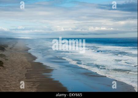 Waves crashing along a beach; Oregon, United States of America - Stock Photo