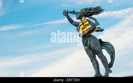 Statue of a woman holding a gold sailing vessel; South Shields, Tyne and Wear, England - Stock Photo