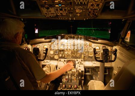 A Pilot In The Cockpit Of An Airplane - Stock Photo