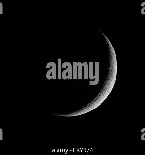 Waxing Crescent, crescent moon against black night sky - Stock Photo