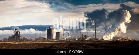 Billows Of Smoke Coming From An Industrial Area; Saltburn, Teesside, England - Stock Photo