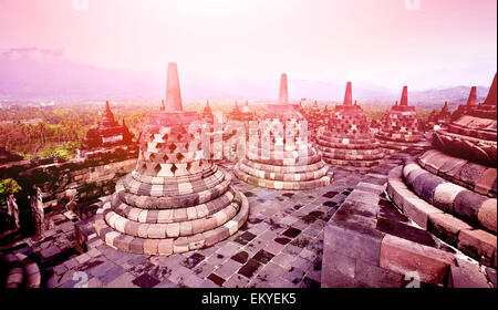 Beautiful ruin of the ancient temple of buddhist temple of Borobudur in East Java, Indonesia - Stock Photo