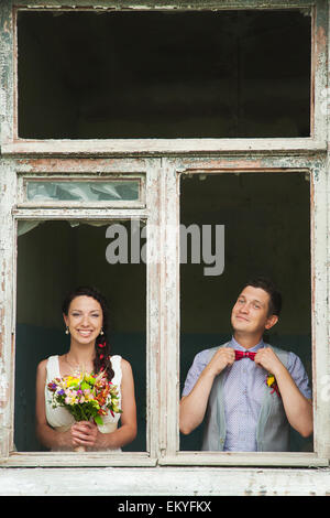 cheerful wedding couple having fun outdoors on wedding day. couple in love. happy bride and groom - Stock Photo