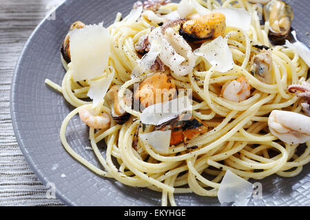 Spaghetti with seafood and cheese, food - Stock Photo