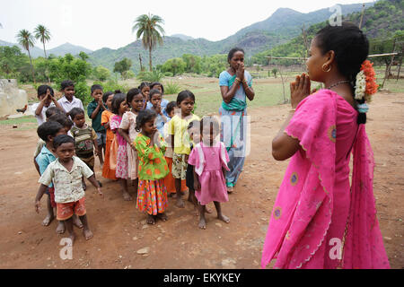 Teachers gather with children to do an outdoor activity; Bangsa Ardual, Andrha Pradesh, India - Stock Photo