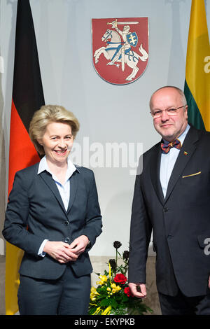 Vilnius, Lithuania. 15th Apr, 2015. German Defense Minister Ursula von der Leyen (CDU, L) is welcomed by Lithuanian - Stock Photo