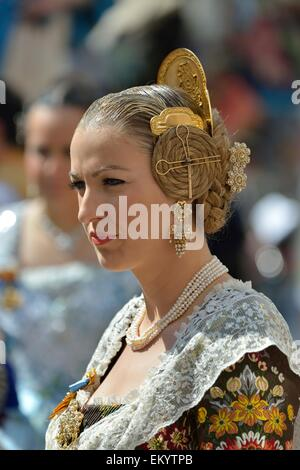 Fallas festival, woman in a traditional costume during the parade in the Plaza de la Virgen de los Desamparados, - Stock Photo
