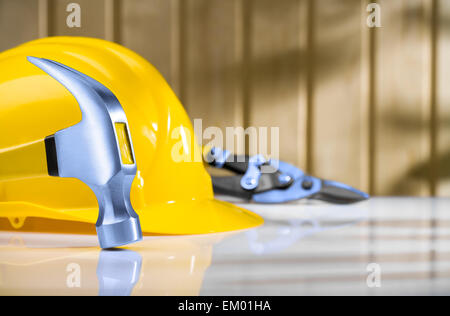 claw hammer with hardhat and steel cutter - Stock Photo