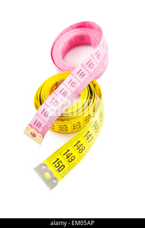 yellow and red measure tapes - Stock Photo