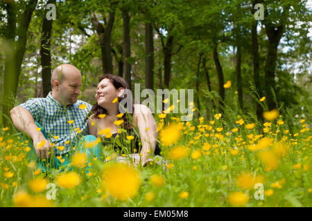 Sweet couple and buttercups - Stock Photo