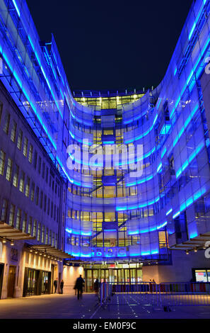 BBC Broadcasting House connecting wing with blue illumination, Portland Place, London W1A, United Kingdom - Stock Photo