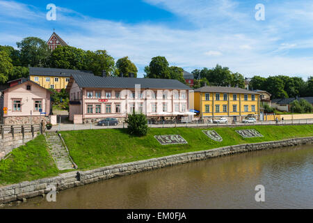Riverside buildings, including cafe, on the river Porvoonjoki in the medieval city of Porvoo, Finland. Porvoo Cathedral - Stock Photo