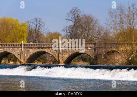 Toll bridge and weir on River Avon at Bathampton - Stock Photo