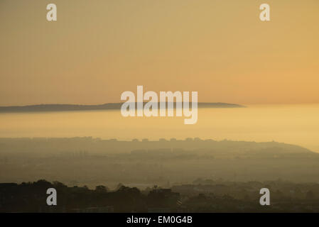 During sunrise fog covers the town of Eastbourne in East Sussex, England. - Stock Photo