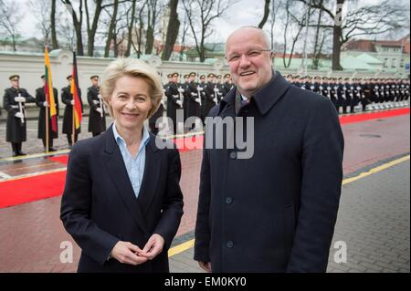 Vilnius, Lithuania. 15th Apr, 2015. Lithuanian defense minister Juozas Olekas (R) welcomes German defense minister - Stock Photo