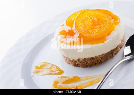 Close up of a vanilla and orange cheesecake - Stock Photo