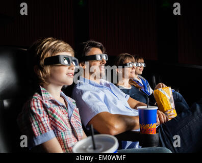 Family Watching 3D Movie In Theater - Stock Photo