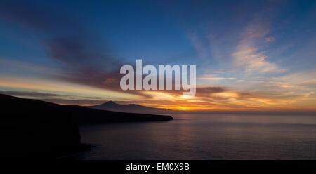 spectacular sunrise over Teide on Tenerife, as seen from La Gomera - Stock Photo