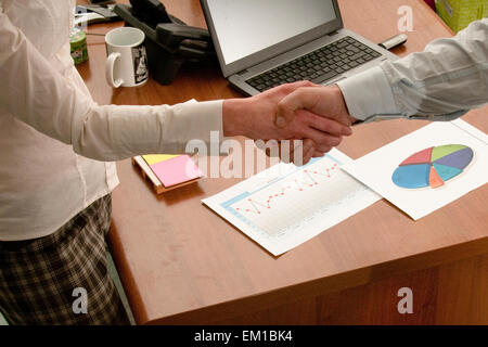 conclusion of a deal and happy business partners - Stock Photo