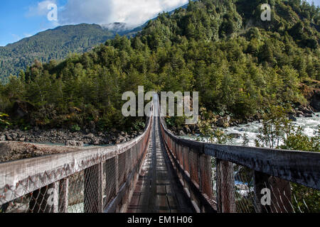 Suspension bridge. Queulat National Park. Aysén Province. Chile - Stock Photo