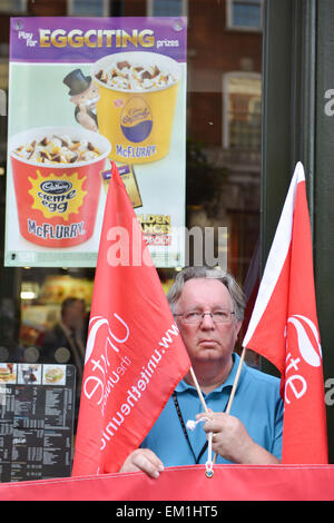 Whitehall, London, UK. 15th April 2015. 'Fast Food Rights', protesters stand outside McDonalds on Whitehall in central - Stock Photo