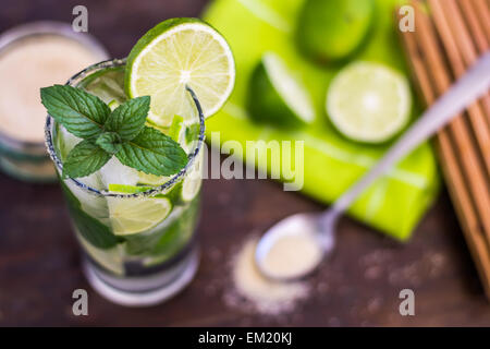 Mojito Lime Alcoholic Drink Cocktail on Wooden Table - Stock Photo