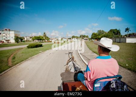 Horse drawn carriage in Moron, Cuba. - Stock Photo