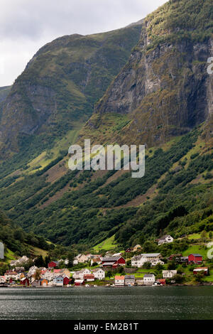 Steep Mountainside With Houses In The Valley Along The Water; Undredal Sognefjord Norway - Stock Photo