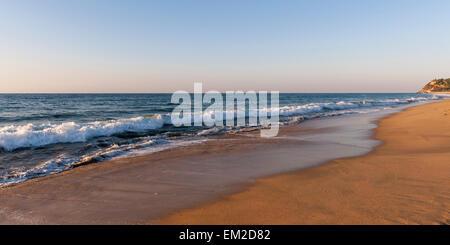 Waves Washing Onto A Beach; Sayulita Mexico - Stock Photo