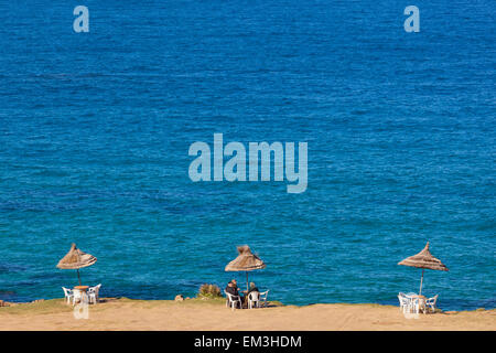 Cafe Umbrellas And Tables On Cliff Edge At Plage Cape Spartel Near Tangiers; Morocco - Stock Photo