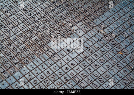 Cast iron letters and numbers flooring in norfolk england UK europe - Stock Photo
