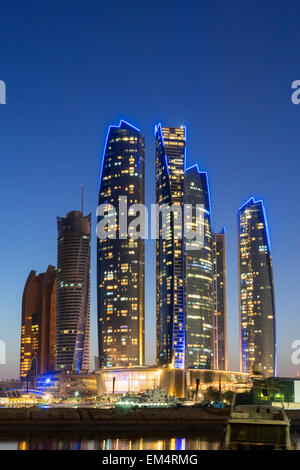 Night skyline view of Etihad Towers  in Abu Dhabi in United Arab Emirates - Stock Photo