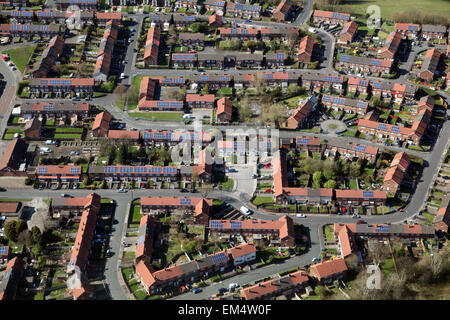 aerial view of UK housing with solar panels - Stock Photo