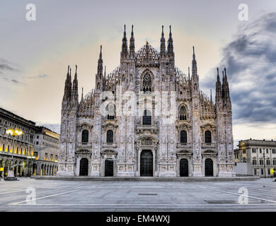 View of Milan Cathedral in Piazza del Duomo at sunrise; Milan, Italy - Stock Photo