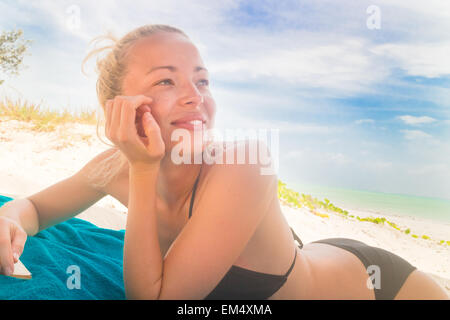 Happy woman in bikini on the beach. - Stock Photo