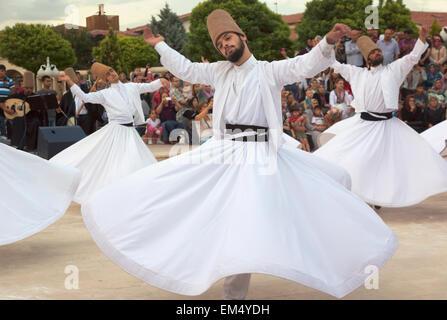 Turkey, Konya Province, Konya, Whirling Dervishes - Stock Photo