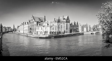 Monochrome panorama view of river canal and houses in Bruges - Stock Photo